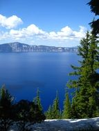 Crater Lake on the background of the Cascade Range in Oregon