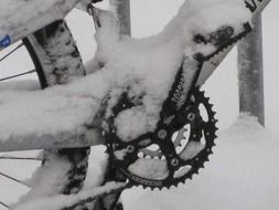 chain and bicycle wheel in snow