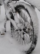 bicycle wheel in snow