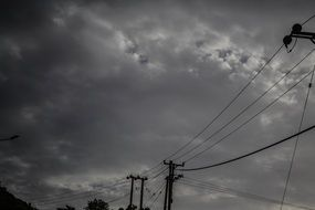 power lines against the backdrop of a stormy sky