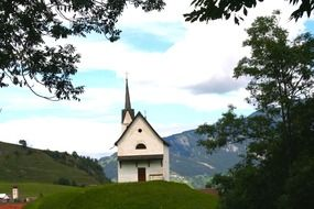 Church on the background of the picturesque landscape of Switzerland