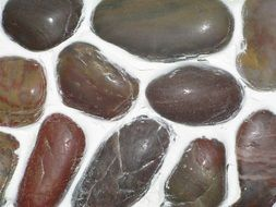 a mosaic of brown stones