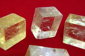 calcite stones on a red background
