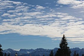 paraglider over the Alpine mountains