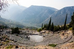 the ruins of an amphitheater in the mountains