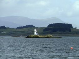 lonely lighthouse on an island in scotland