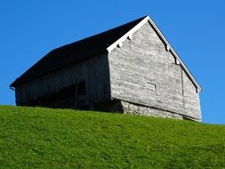 wooden barn on top of a hill