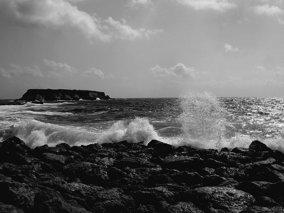 black and white photo of sea waves beating on the coast of Cyprus