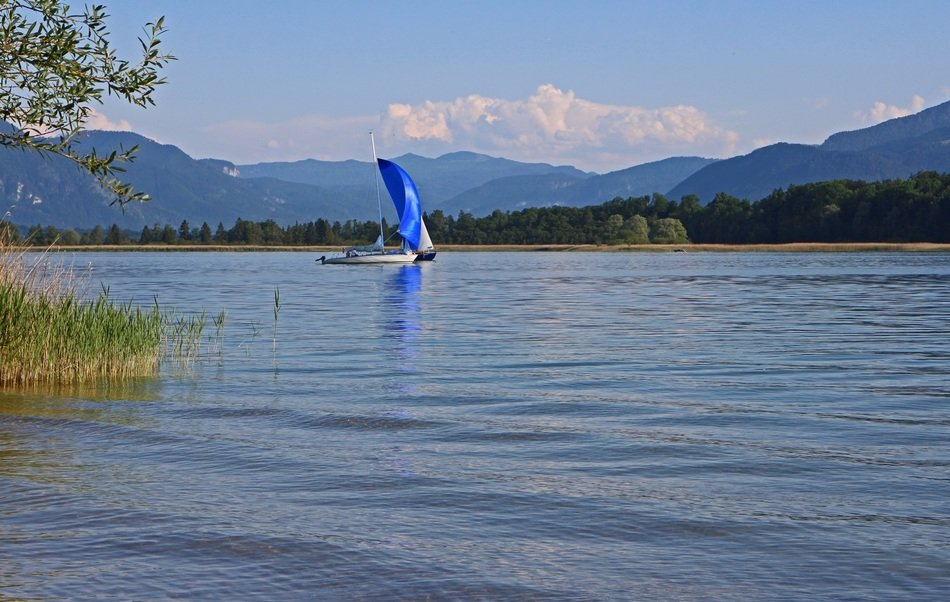 blue sailing ship on chiemsee lake