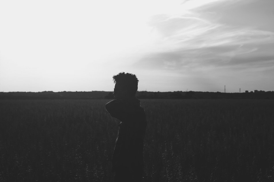 silhouette of a man in a field