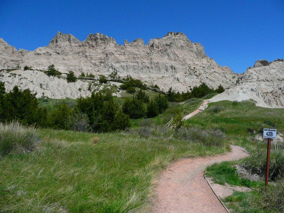 trail to the mountains in the badland national park, south dakota