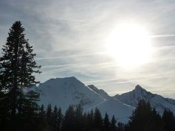 bright sun over the alpine mountains