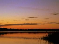 Romantic orange sunset over a lake in Sweden