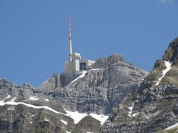 transmission tower on the mountain peak in switzerland