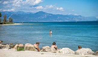 lake garda beach mountain view