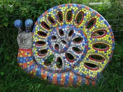 garden sculpture in the form of a colorful snail