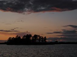 island on saimaa lake at dusk, finland