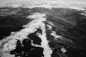 panoramic view of snowy mountain peaks in black and white image