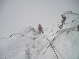 rope descent in snowy mountains
