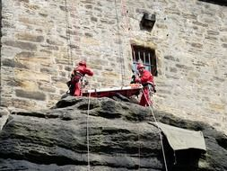 lifeguards with ropes on a cliff