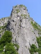 Vertical rock on the blue sky background
