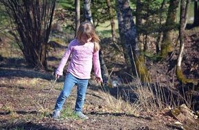 little girl in the spring forest
