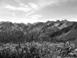 black and white photo of beautiful alpine mountains