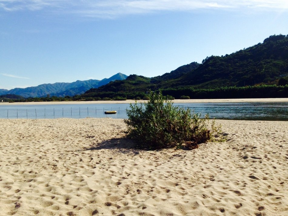 landscape with sand beach and distant mountains, South Korea, seomjin river
