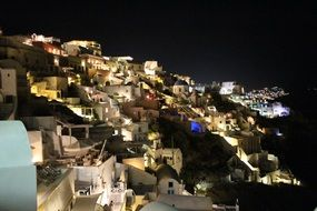 night city on a hill in Santorini, Greece