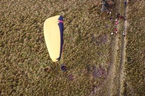 paragliding over the field