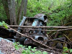the remains of a car shredder near a tree