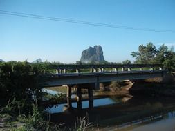 distant view of the mountain through a small bridge