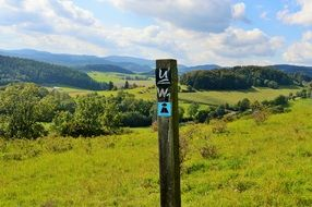 directory sign hiking trail Green field view