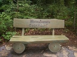 wooden bench with inscription