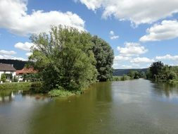 panorama of a village by the river in Bavaria