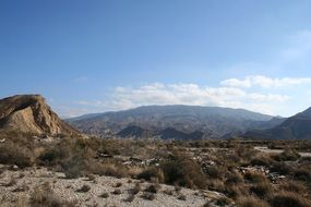 A desert landscape against a background of mountains in Andalusia