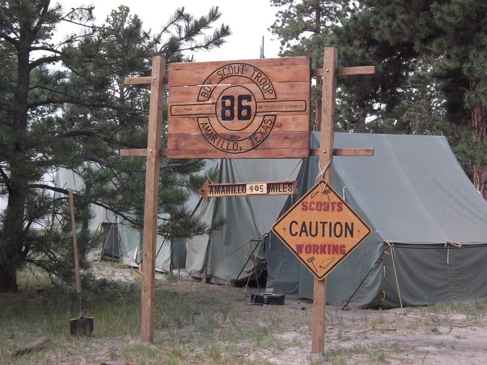 boy scout's camp, signs and tents in forest