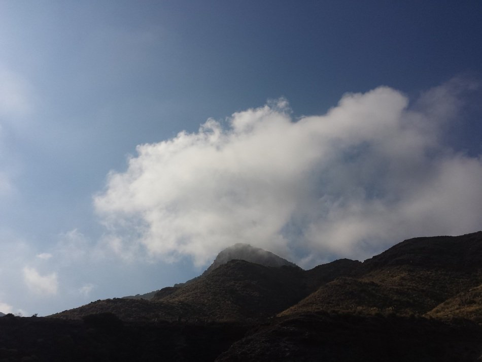 white cloud in the blue sky over the mountain