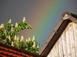rainbow over a house roof