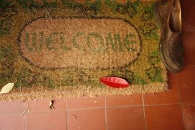 welcome home mat sign door