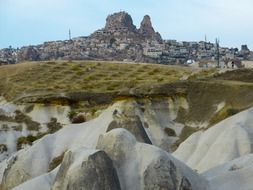 distant ancient city on tufa rock, turkey, uchisar