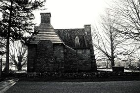 black and white picture of a stone house