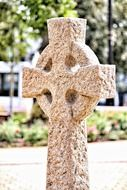 stone cross on a tombstone