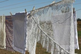 lace laundry hanging on line outdoor at summer