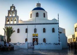 white church with bell tower on Santorini island, Greece