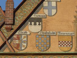 coat of arms on a facade wall