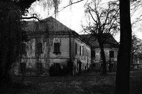 Abandoned shabby house in black and white