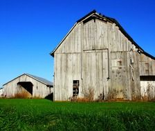 wooden barn buildings at farm