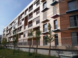 facade of new long wooden low consumption building