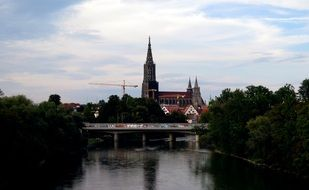 bridge across danube river in front of ulm cathedral, germany, munich